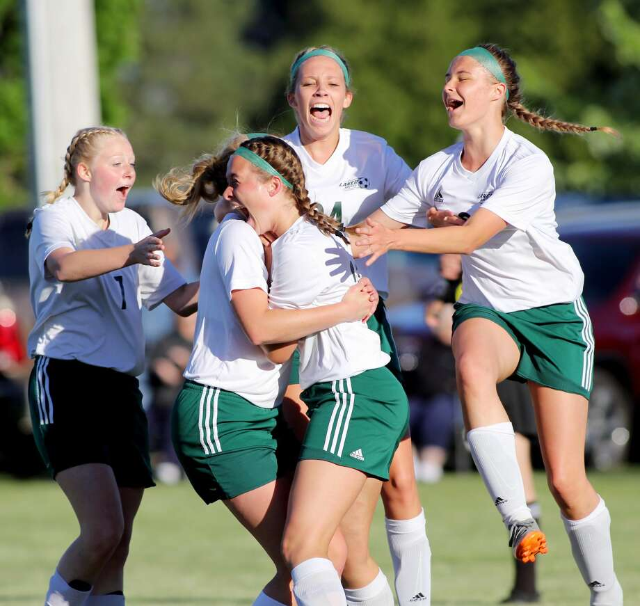 EPBP soccer player Halle Keim celebrates with her teammates after scoring the game-winning goal in the Division 4 district championship game.  Photo: Tribune File Photo