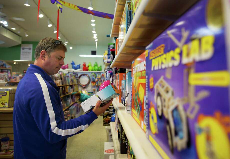 Matt Villarreal of Monroe, LA, looks at STEM-related toys in the Science Center at FUNdamentally Toys in Rice Village on Saturday, Jan. 13, 2018. Villarreal was shopping with his 11-year-old son, Sawyer, for presents for a belated family Christmas gathering. (Annie Mulligan / Freelance) Photo: Annie Mulligan, Freelance / Annie Mulligan / @ 2018 Annie Mulligan