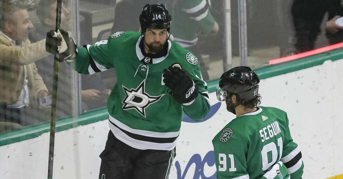Dallas Stars left wing Jamie Benn, left, celebrates his goal with Dallas Stars center Tyler Seguin, right, against the Edmonton Oilers during the third period of an NHL hockey game Monday, Dec. 3, 2018, in Dallas. (AP Photo/Ray Carlin)