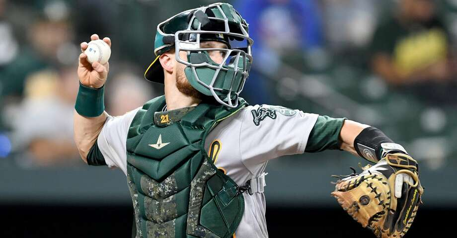 BALTIMORE, MD - SEPTEMBER 11:  Jonathan Lucroy #21 of the Oakland Athletics throws the ball to second base against the Baltimore Orioles at Oriole Park at Camden Yards on September 11, 2018 in Baltimore, Maryland.  (Photo by G Fiume/Getty Images) Photo: G Fiume/Getty Images