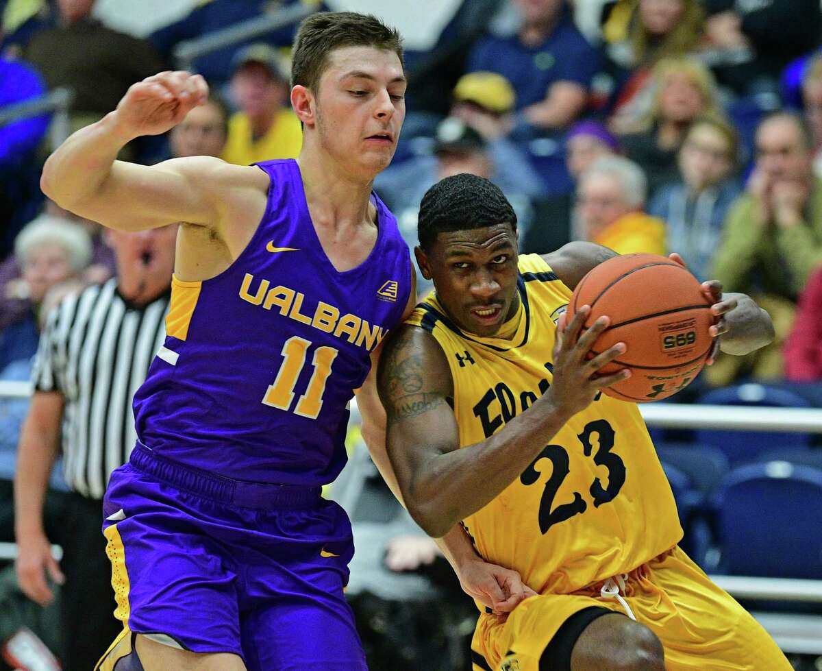 Kent State's Jaylin Walker drives on UAlbany's Cameron Healy during the first half of their game, Saturday night at the Memorial Athletic and Convocation Center. Kent State won 70-68. (David Dermer / Record-Courier)