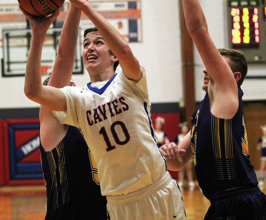 Carlinville's Jarret Easterday (10) gets between Mount Olive's Max Schwab (right) and Ricky Naecker to score in a Cavalers' victory Wednesday at the Carlinville Tourney. Photo: Greg Shashack / The Telegraph