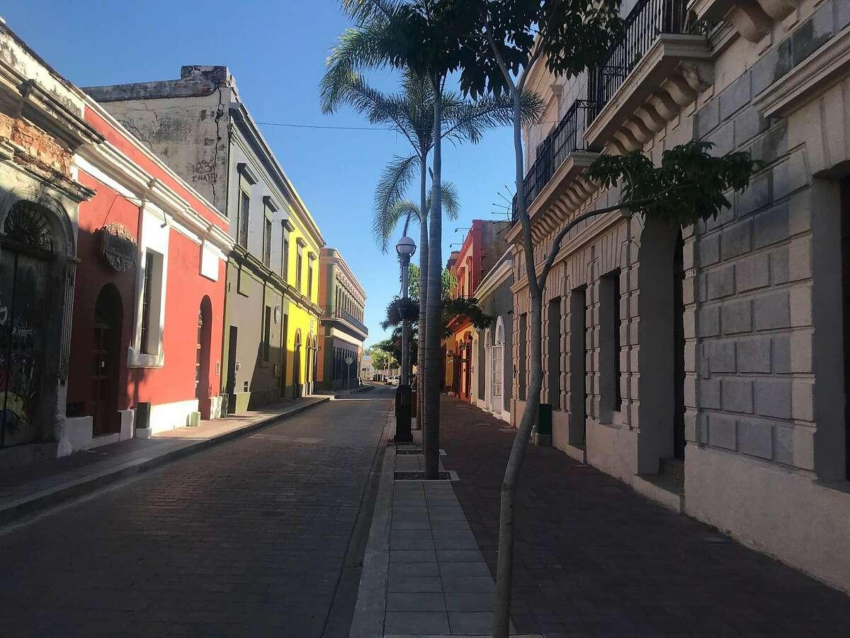 1) A Mexican flag flies in Puerto Vallarta 2) The cruise ship Grand Princess in Manzanillo, Mexico 3) Calle Ninos Heroes, a street in Mazatl�n. Mexico 4) a store in the historic Centro district Mazatl�n, Mexico