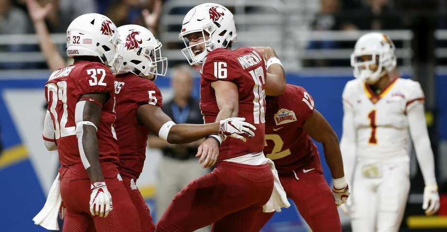 SAN ANTONIO, TX - DECEMBER 28:  Gardner Minshew #16 of the Washington State Cougars celebrates with teammates after a rushing touchdown in the second quarter against the Iowa State Cyclones during the Valero Alamo Bowl at the Alamodome on December 28, 2018 in San Antonio, Texas.  (Photo by Tim Warner/Getty Images) Photo: Tim Warner/Getty Images