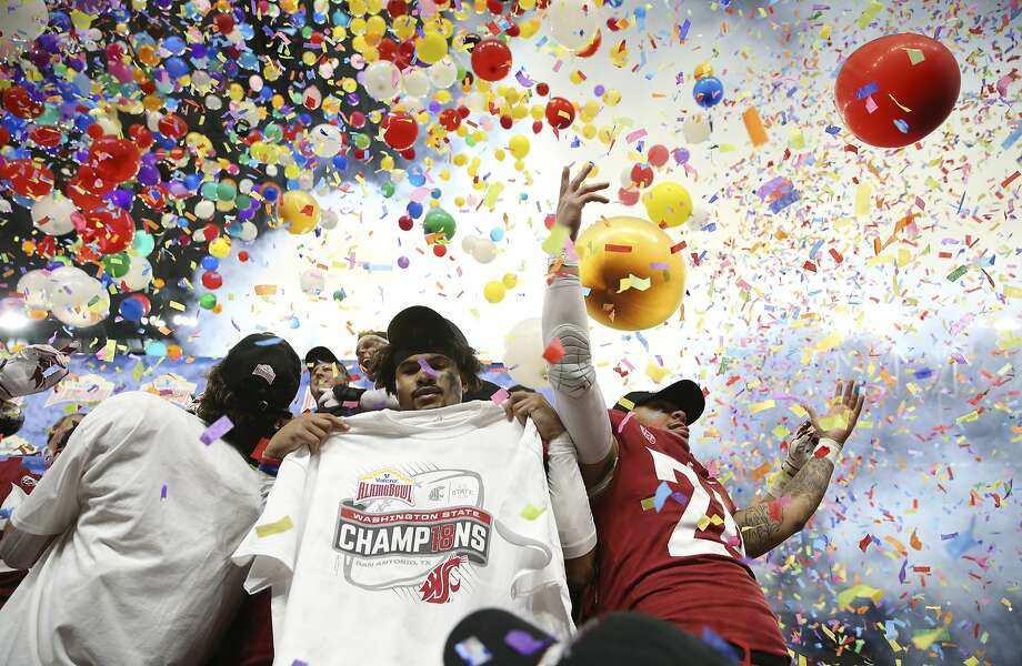 Washington State players celebrate amid falling balloons and confetti after defeating Iowa State in the 2019 Valero Alamo Bowl at the Alamodome on Friday, Dec. 28, 2018. The Cougars defeated the Cyclones, 28-26. (Kin Man Hui/San Antonio Express-News) Photo: Kin Man Hui, San Antonio Express-News