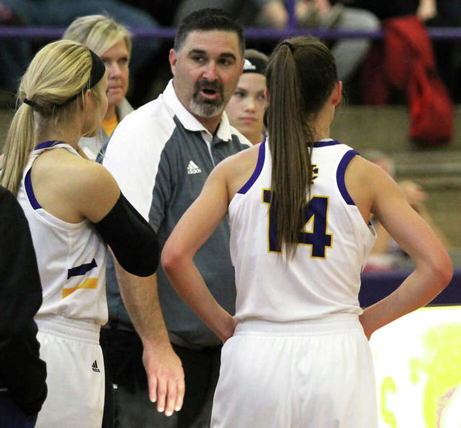 CM coach Jonathan Denney (middle) had his Eagles playing for seventh place Friday night at the State Farm Classic after a loss to Chicago Kenwood earlier in the day. Photo: Greg Shashack / The Telegraph