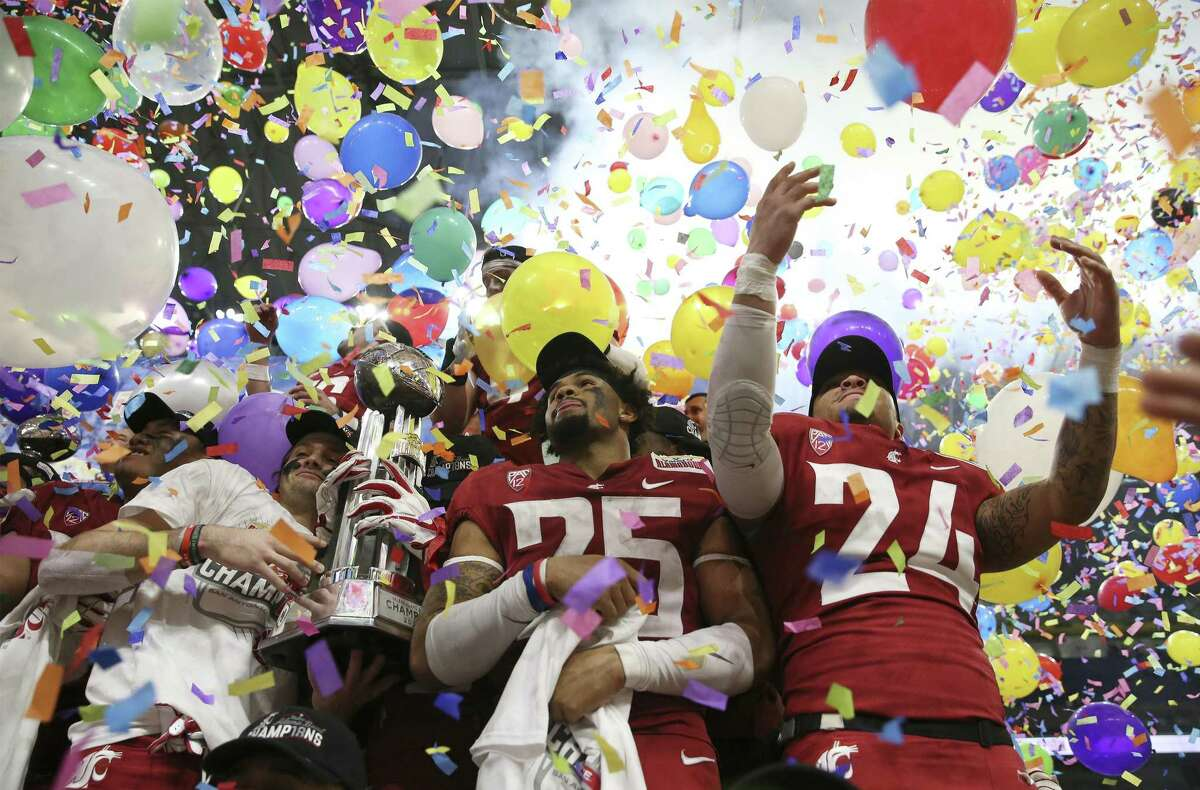 Players from Washington State celebrate amid balloons and confetti after defeating Iowa State in the 2019 Valero Alamo Bowl at the Alamodome on Friday, Dec. 28, 2018. The Cougars defeated the Cyclones, 28-26. (Kin Man Hui/San Antonio Express-News)