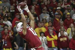 Dezmon Patmon hauls in a touchdown pass for the Cougars in the second quarter as Washington State plays Iowa State in the Valero Alamo Bowl on December 28, 2018.
