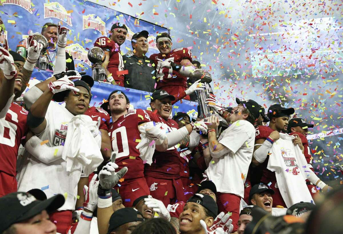 The Cougars celebrate their victory as Washington State beats Iowa State 28-26 in the Valero Alamo Bowl on December 28, 2018.