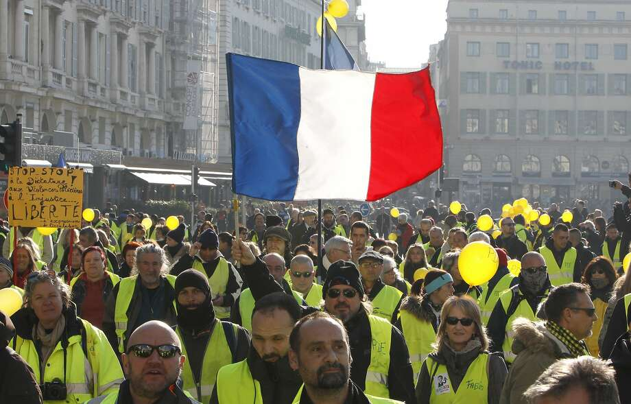 """Yellow vest"" protesters rally in Marseille. Turnout was much smaller than in previous weekends. Photo: Claude Paris / Associated Press"