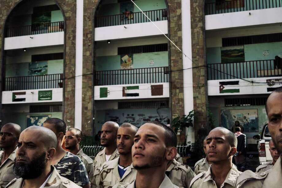 Militia members perform a morning military training in the al Najah school, headquarter of Abu al Abbas militia in the old city of Taiz, Yemen. Photo: Photo For The Washington Post By Lorenzo Tugnoli / Lorenzo Tugnoli