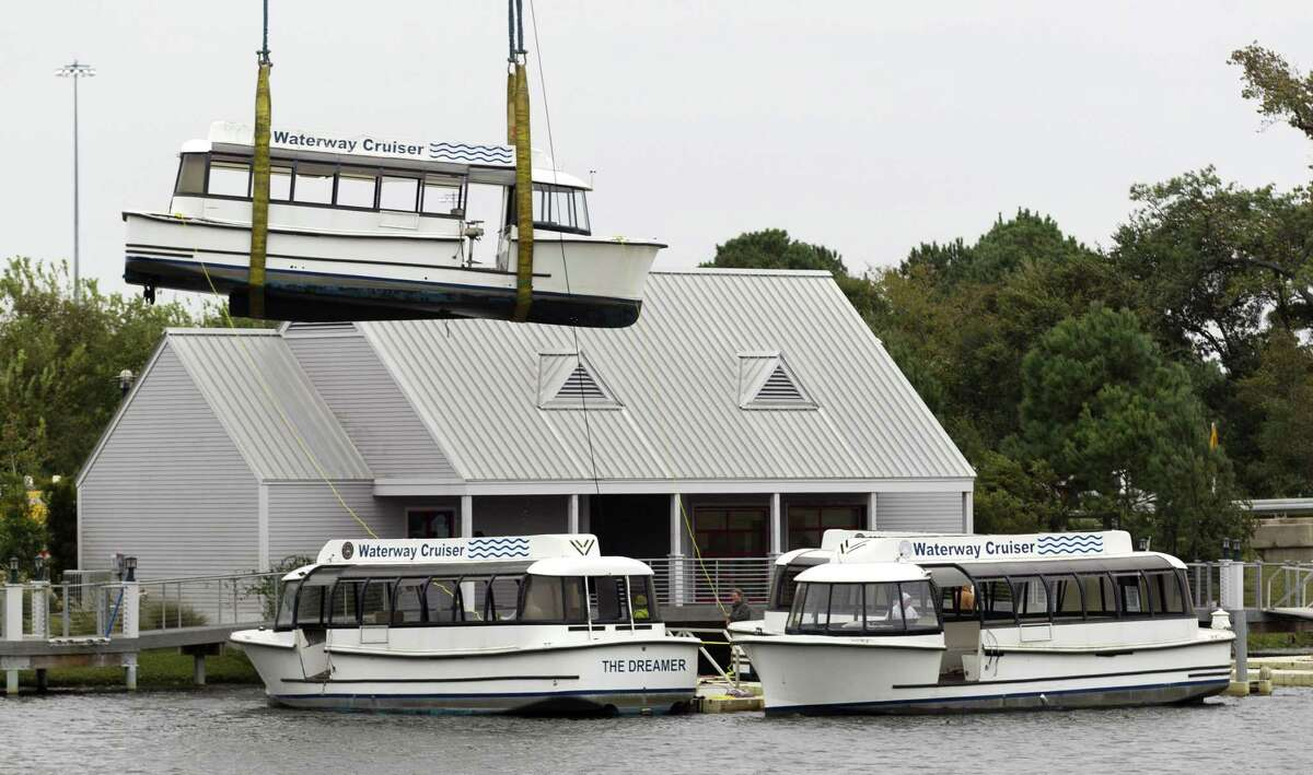 The Woodlands Waterway Cruisers are removed from their dock in front of The Woodlands Mall, Nov. 13, 2018.