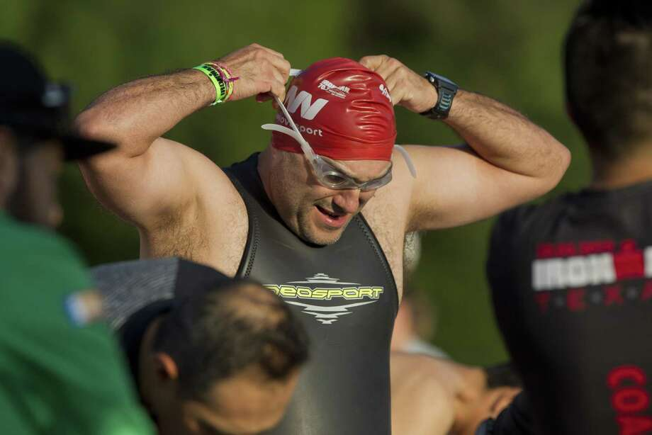 PHOTOS: Scenes from IRONMANThe Open Water Swim Day & First Timer's Clinic, co-hosted by The Woodlands Township, is scheduled for 8-11 a.m., Saturday, May 4, at Northshore Park, 2505 Lake Woodlands Drive. In this archive photograph, Javier Fernandez of Monterrey, Mexico, adjusts his goggles before taking part in the practice Ironman swim session at Northshore Park, Friday, April 27, 2018, in The Woodlands.>>>See more for scenes from last year's IRONMAN race... Photo: Jason Fochtman, Staff Photographer / Houston Chronicle / © 2018 Houston Chronicle