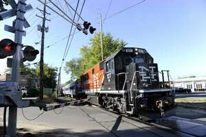 A Metro-North train nears the Bethel train station in this 2013 file photo. Notice the diesel engine.
