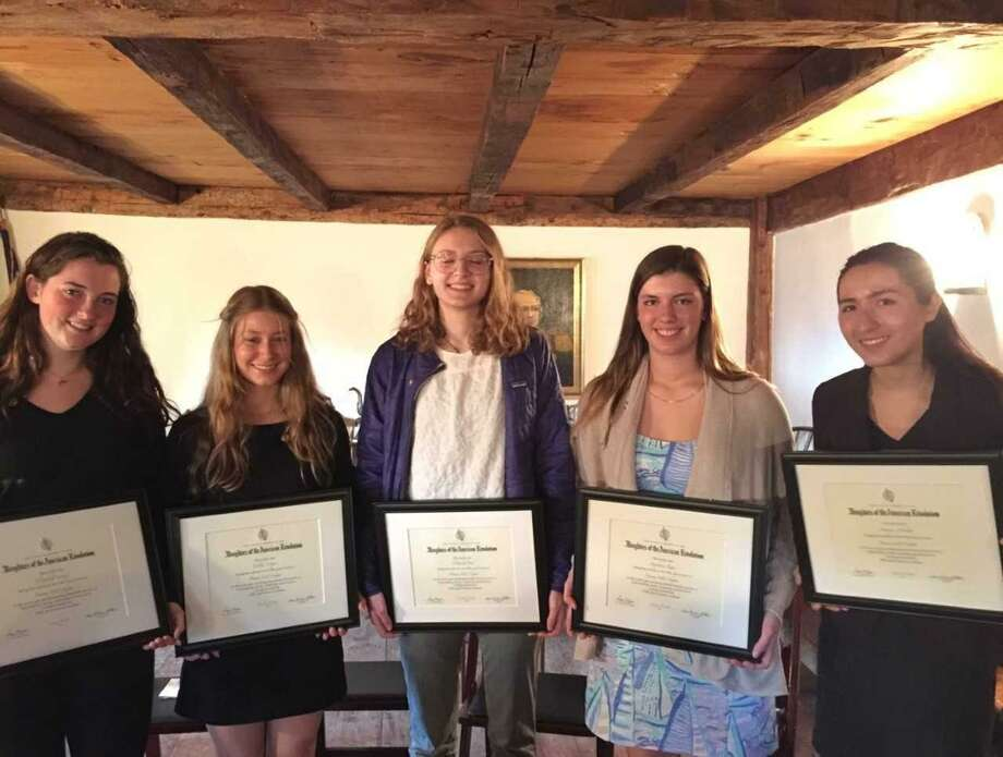 From left, Elizabeth Cassidy, Colette Cooper, Elizabeth Peck, Stephanie Rota, and Monique Nikolov display their Good Citizens Awards. The Greenwich High students received the honor from the Putnam Hill Daughters of the American Revolution. Photo: Contributed /