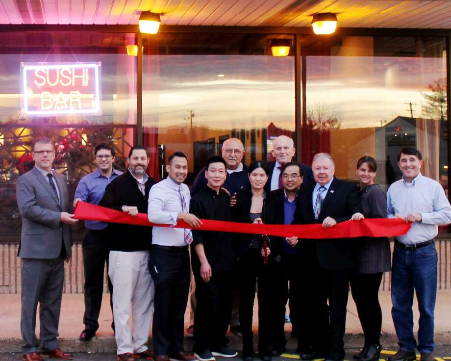 Mizzu Asian Bistro & Hibachi recently held a grand opening at 136 Berlin Road in Cromwell. From left are Middlesex County Chamber of Commerce Cromwell Division Chair Rodney Bitgood, Councilman James N. Demetriades, Mayor Enzo Faienza, General Manager Sambot Orm, Co-Owner Xin Hua Liu, Manager Michele Chen, Town Manager Tony Salvatore, Chamber President Larry McHugh, Owner Bill Chen, Chamber Chairman Jay Polke, state Rep. Christie Carpino, and Cromwell Director of Planning & Development Stuart B. Popper. Photo: Contributed Photo