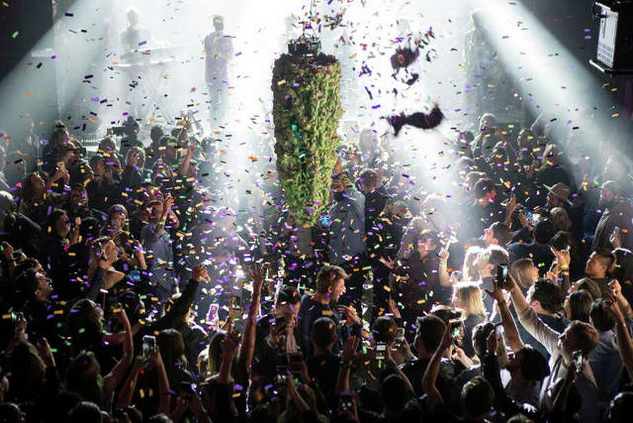 In this Oct. 17, 2018, file photo a depiction of a cannabis bud drops from the ceiling at Leafly's countdown party in Toronto as midnight passes and marks the first day of the legalization of cannabis across Canada. The last year was a 12-month champagne toast for the legal marijuana industry as the global market exploded and cannabis pushed its way further into the financial and cultural mainstream. Canada ushered in broad legalization, U.S. drug regulators approved the first cannabis-based drug and investors pumped in billions of dollars. Photo: Chris Young/The Canadian Press Via AP, File