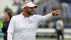 SEATTLE, WA - SEPTEMBER 29:  Washington head coach defensive coordinator Jimmy Lake instructs his players before the college football game between the Washington Huskies and the BYU Cougars on September 29, 2018 at Husky Stadium in Seattle, WA.  (Photo by Jesse Beals/Icon Sportswire via Getty Images)