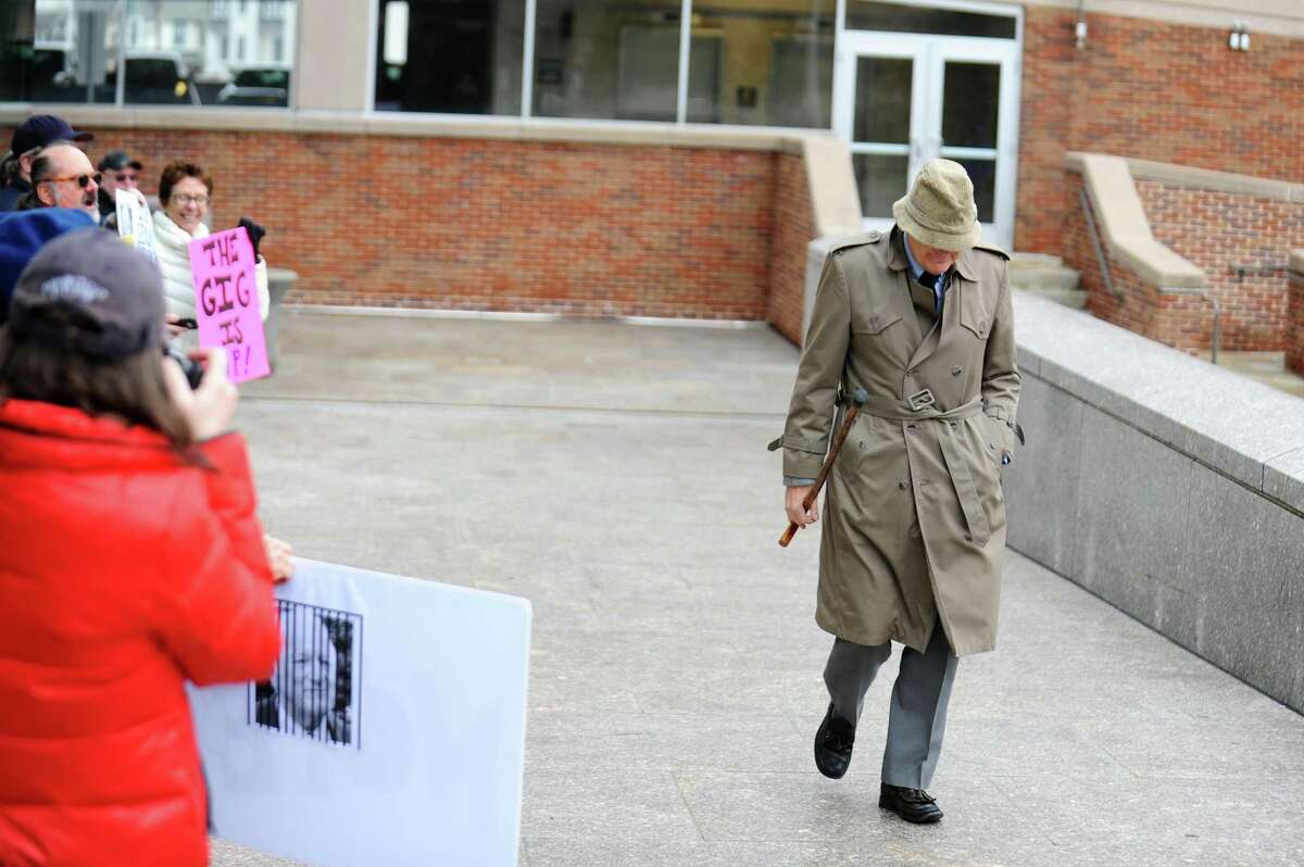 Chris Von Keyserling, a member of Greenwich's Representative Town Meeting, walks past protestors towards Stamford Superior Court in Stamford, Conn. on Wednesday, Feb. 22, 2017. Von Keyserling was arrested on Jan. 11 and charged with a class A misdemeanor after allegedly groping a woman after the two had an argument.