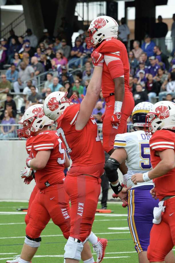 Cole Birmingham (77) of Katy hoists Deondrick Glass (2) in the air to celebrate his touchdown in the first quarter of a Class 6A Div. I Reg. III area-round playoff game between the Katy Tigers and the Jersey Village Falcons on Friday, November 23, 2018 at Legacy Stadium, Katy, TX. Photo: Craig Moseley, Houston Chronicle / Staff Photographer / ©2018 Houston Chronicle