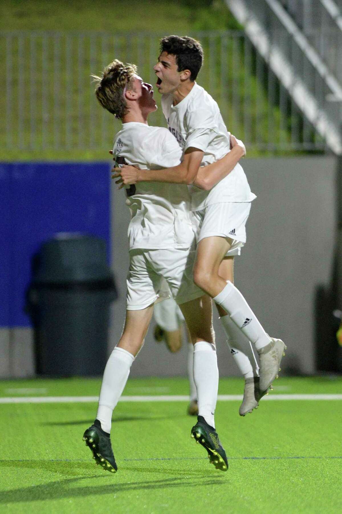 Defender Joe Burt (6) and Forward Daniel Garay (11) of Cinco Ranch react after Burt's goal during the second half of a 6A-III area round soccer playoff between the Cinco Ranch Cougars and the Cy Lakes Spartans on Tuesday, April 3, 2018 at Legacy Stadium, Katy, TX.