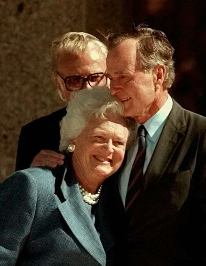 In this Nov. 6, 1997, file photo, former President George H.W. Bush hugs his wife, Barbara, after speaking at the dedication of the George Bush Presidential Library in College Station, Texas. The Bushes were married Jan. 6, 1945, and have had the longest marriage of any presidential couple in American history. Photo: Pat Sullivan, STF / AP / AP1997