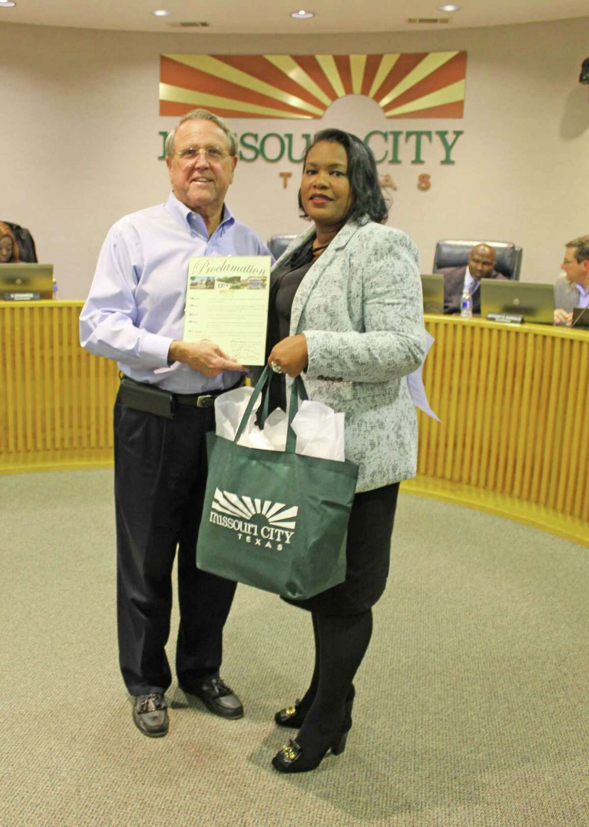 Outgoing Missouri City Mayor Allen Owen presents a proclamation to incoming Mayor Yolanda Ford during a ceremony on Dec. 17, 2018, in Council Chambers.