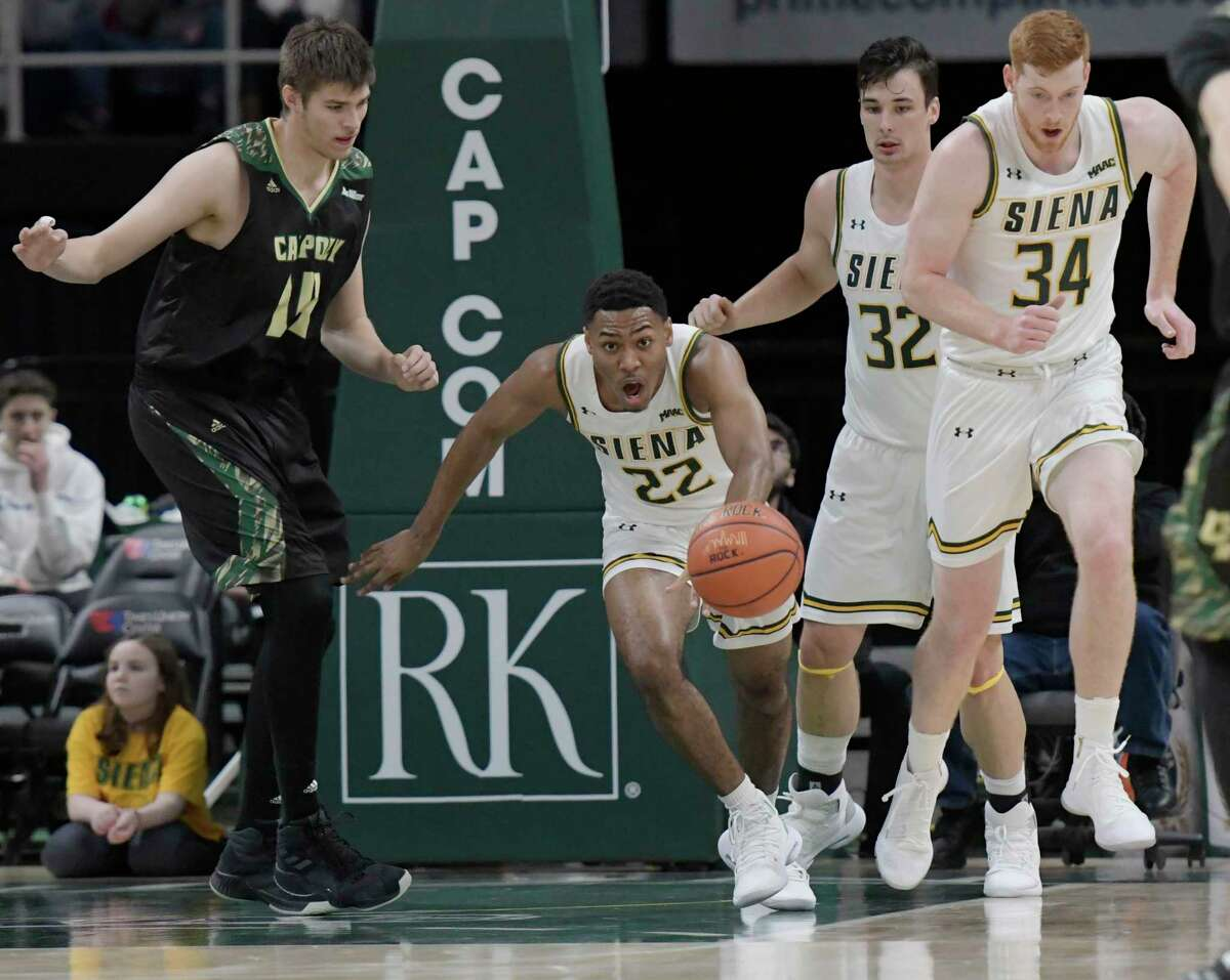 Siena guard Jalen Pickett dribbles the ball down the court after gaining possession during a game against Cal Poly Saturday, Dec. 29, 2018 at the Times Union Center. (Phoebe Sheehan/Times Union)