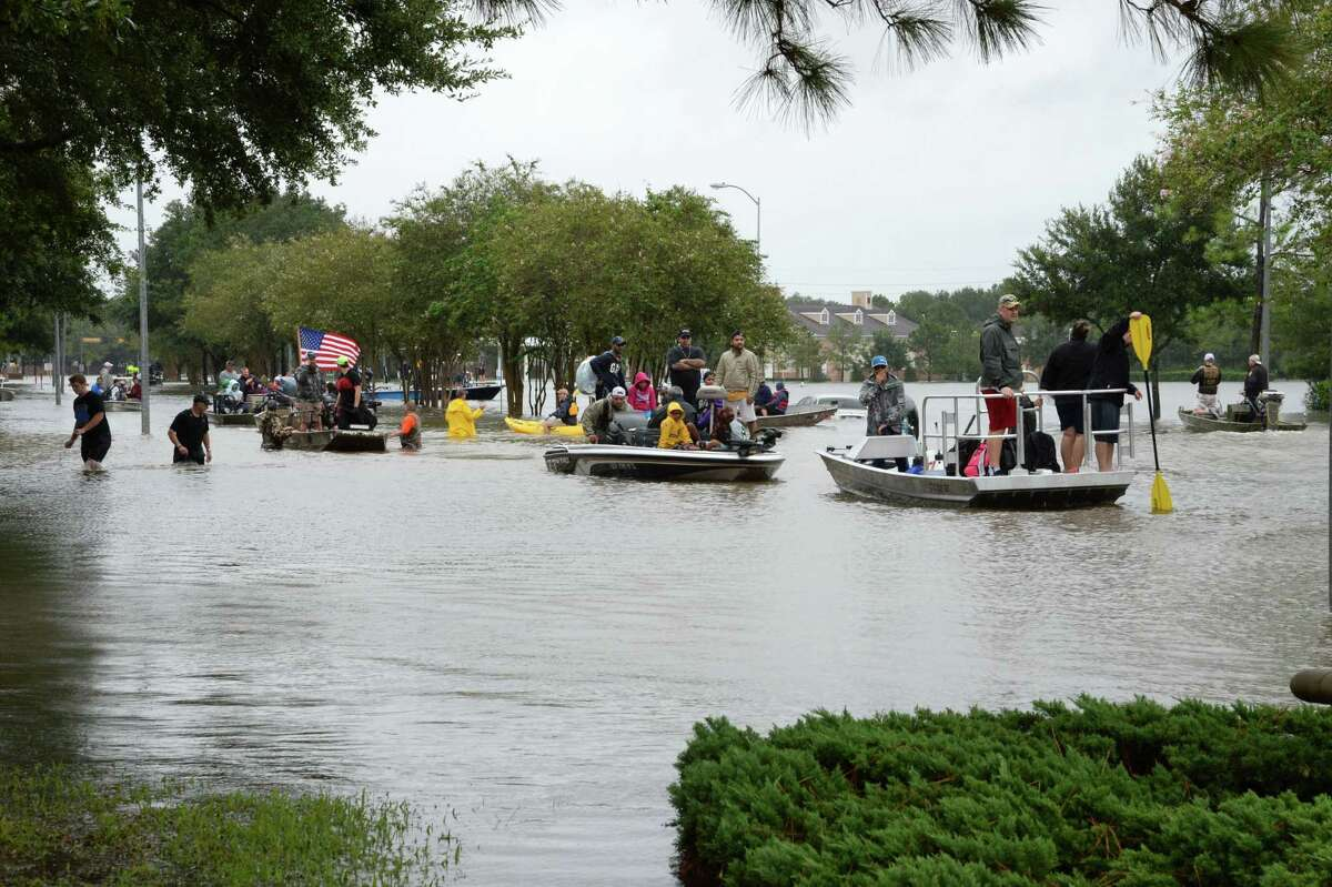 Residents of the Cinco Ranch and Kelliwood areas of Ft. Bend and Harris Counties evacuate from the west side of the Barker Reservoir along Westheimer Parkway in Katy, TX on August 29, 2017.