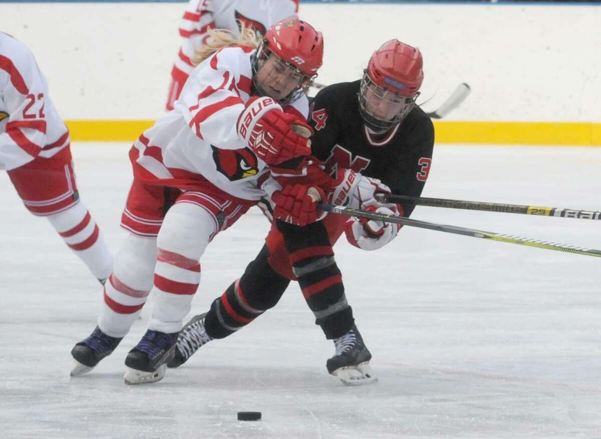 Greenwich's Jennifer Kelly (18) and New Canaan's Angelica Megdanis collide near center ice during the Winter Classic at the Greenwich Skating Club on Saturday.