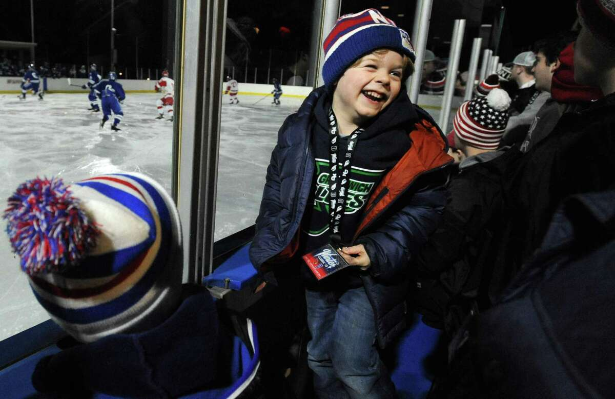 Willett Carpenteri, 6, of Greenwich enjoys the Winter Classic Saturday, December 29, 2018, where the Greenwich High School Cardinals takes on the Darien Blue Wave in their boys hockey game at the Greenwich Skating Club in Greenwich, Conn.