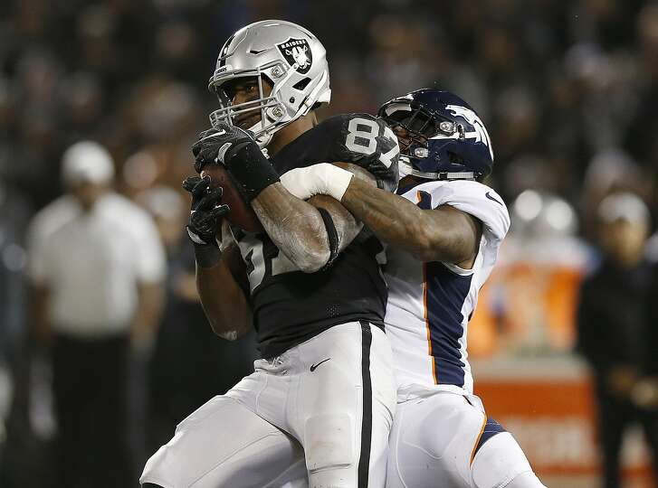 Oakland Raiders tight end Jared Cook (87) runs against the Denver Broncos during the first half of an NFL football game in Oakland, Calif., Monday, Dec. 24, 2018. (AP Photo/D. Ross Cameron)