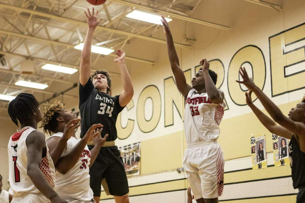 Conroe senior Devin Meek (34) shoots over the Westfield defense during the 54th annual Conroe Christmas Classic on Saturday, Dec. 29, 2018 at Conroe High School in Conroe.