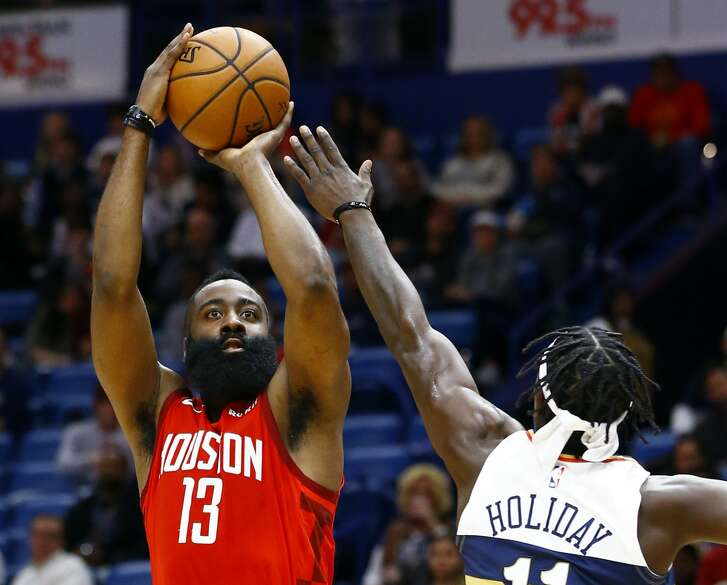 Houston Rockets guard James Harden (13)  shoots over New Orleans Pelicans guard Jrue Holiday (11) during the first half of an NBA basketball game, Saturday, Dec. 29, 2018, in New Orleans. (AP Photo/Butch Dill)