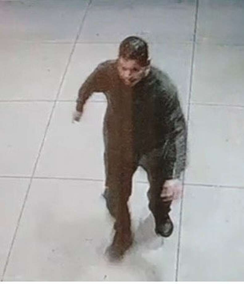 Palo Alto police officers are searching for a man they say sexually assaulted a woman on the 2500 block of El Camino Real near Grant Avenue early Saturday morning. A surveillance camera captured a photo of the suspect, who was wearing dark clothing. Photo: Palo Alto Police Department