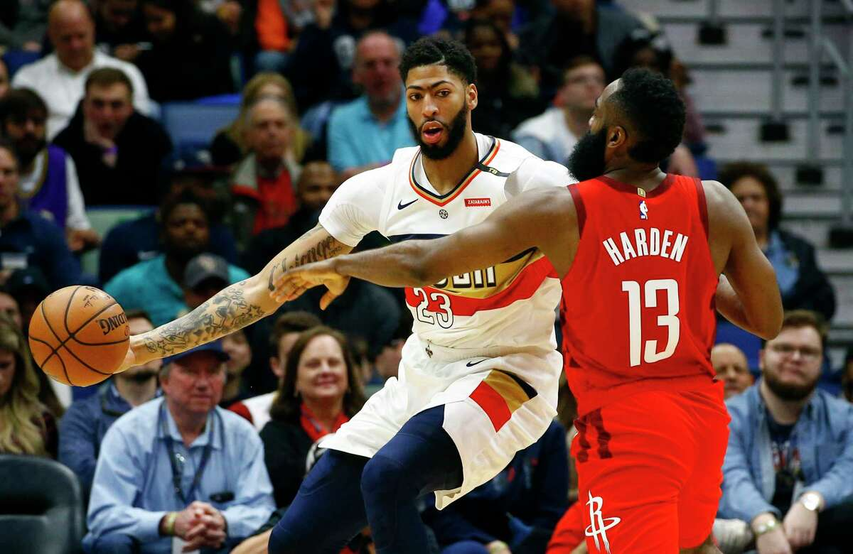 New Orleans Pelicans forward Anthony Davis (23) tries to get around Houston Rockets guard James Harden (13) during the first half of an NBA basketball game, Saturday, Dec. 29, 2018, in New Orleans. (AP Photo/Butch Dill)