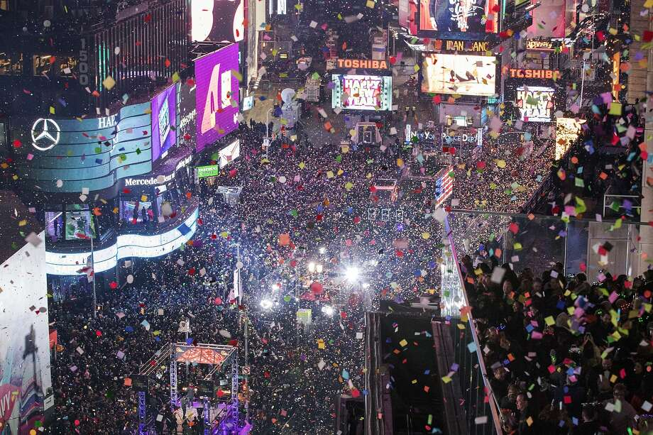 FILE - In this Jan. 1, 2017 file photo, revelers celebrate the new year as confetti flies over New York's Times Square. Year after year, people watching New York City's New Year's Eve celebration are told by city dignitaries and TV personalities that they are watching a million people gathered in Times Square. The AP asks experts whether it is actually possible to fit that many people into the viewing areas. (AP Photo/Mary Altaffer, File) Photo: Mary Altaffer, Associated Press