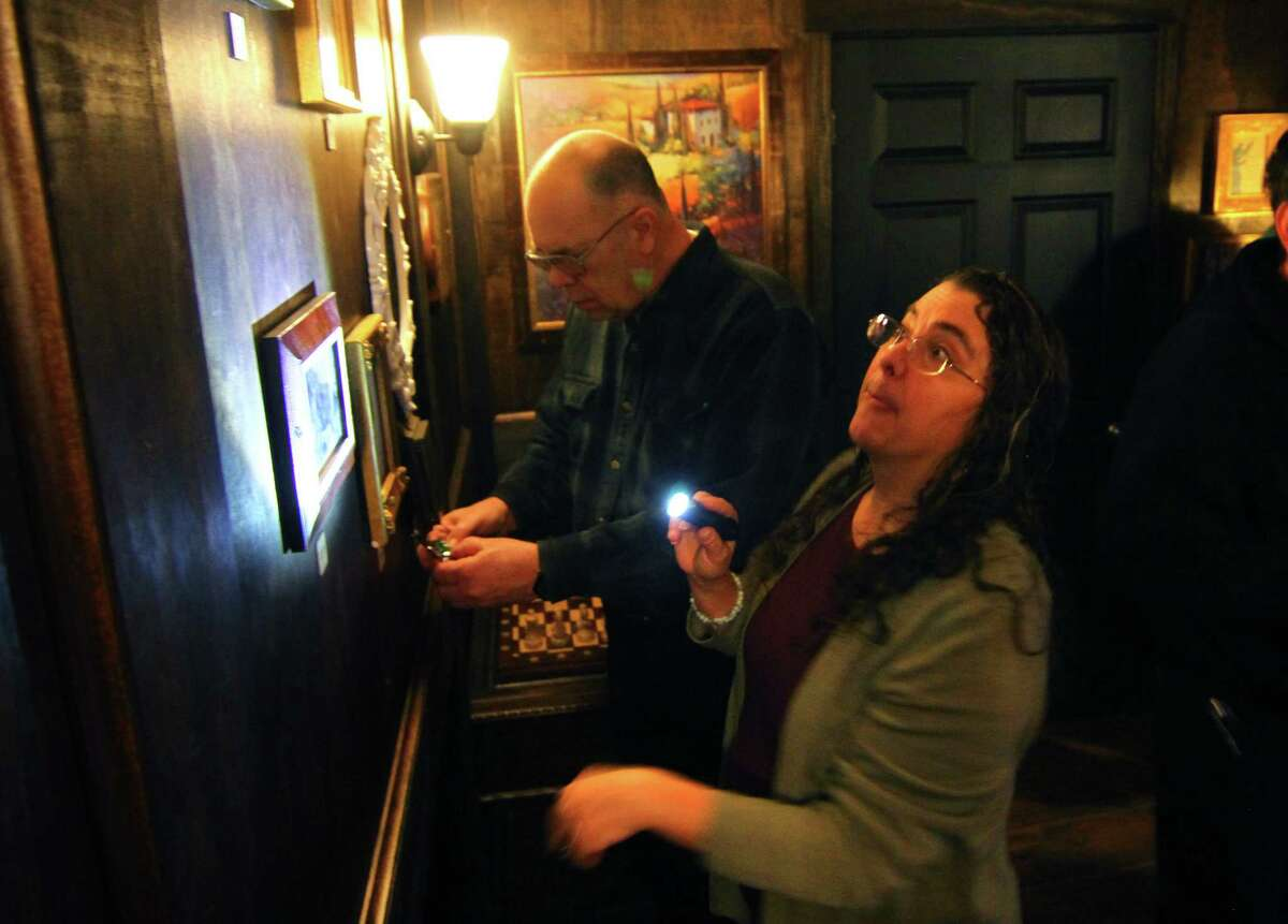 Cheryl-Ann Muzyka, of Seymour, right, searches for clues with her friends inside the
