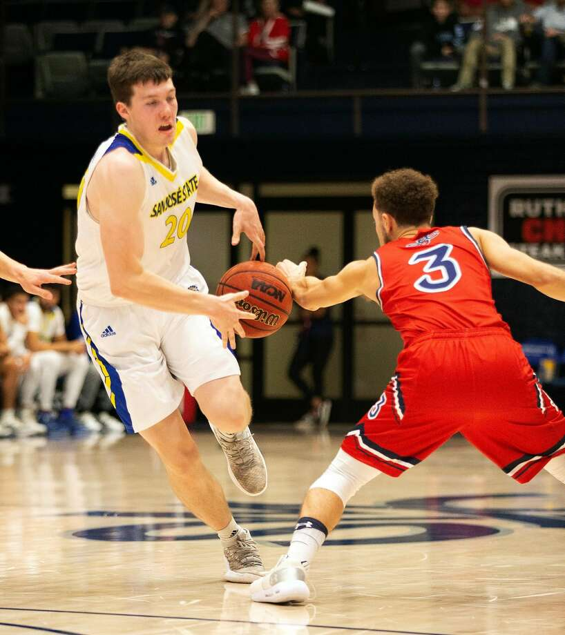 Saint Mary's Jordan Ford (3) steals the ball from San Jose State's Noah Baumann (20) during the first half of an NCAA men's basketball game, Saturday, Dec. 29, 2018 in Moraga, Calif. Photo: D. Ross Cameron / Special To The Chronicle