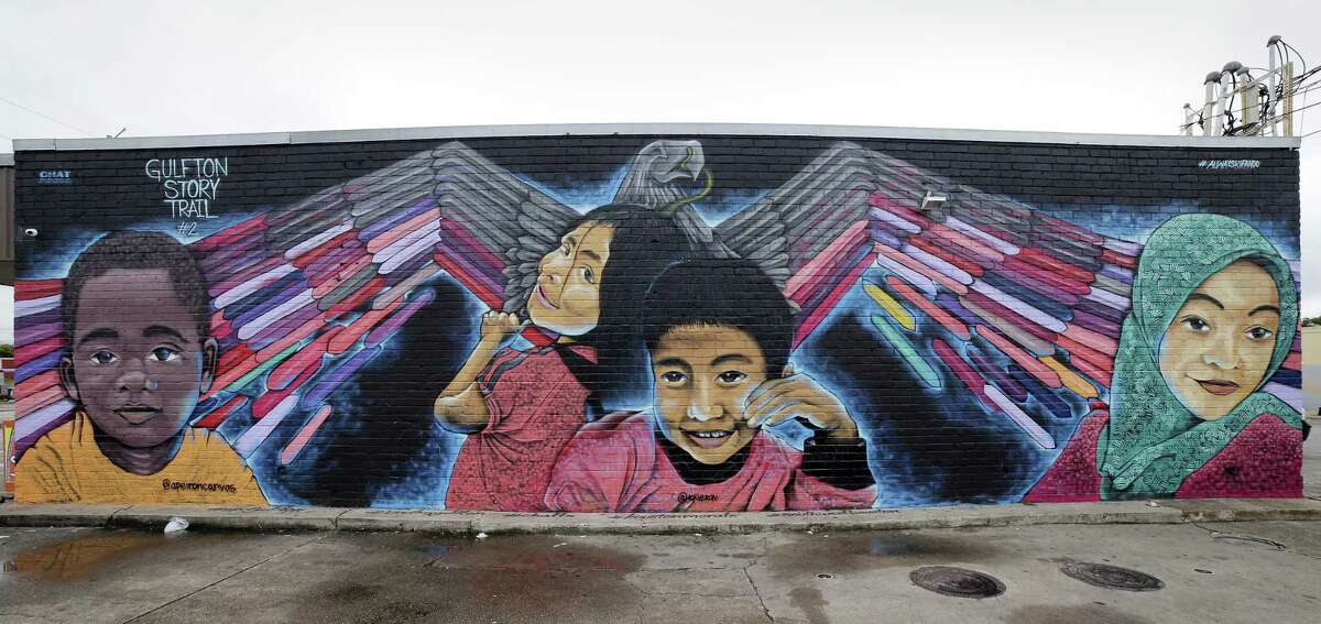 """Artist Jesus Sanchez's mural """"Celebration of Diversity"""" at 5905 Rampart St., one of the 12 murals in the Gulfton Story Trail sponsored by CHAT, Culture of Health Advancing Together, Thursday, Oct. 25, 2018 in Gulfton the neighborhood in Houston, TX."""