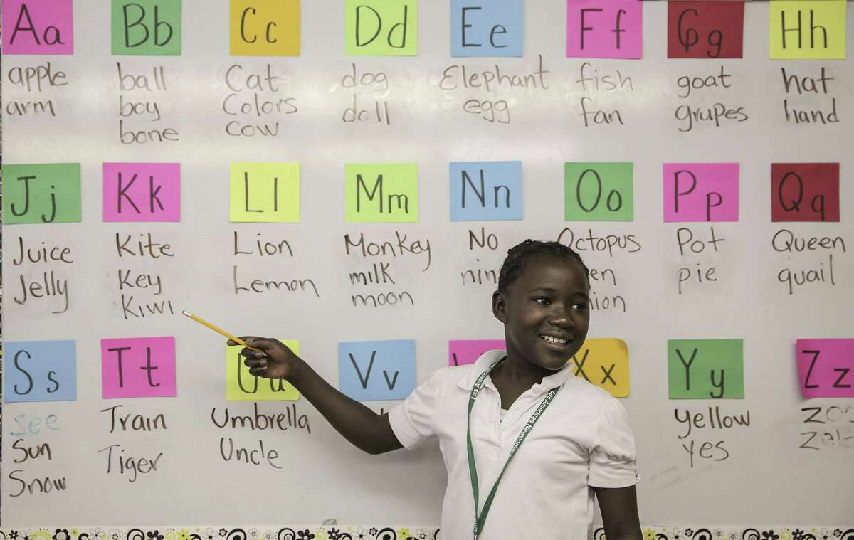 Glorioza Shimirimana goes over the alphabet in her class at Las Americas, a school for newcomer immigrants, on Friday, Oct. 14, 2016, in Houston.
