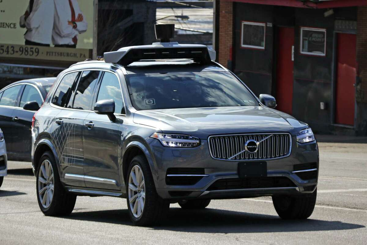 This March 17, 2017, photo shows an Uber self-driving Volvo in Pittsburgh. The Pennsylvania Department of Transportation has approved Uber's request to resume testing of autonomous vehicles on public roads in the Pittsburgh area. The approval, effective Monday, Dec. 17, 2018, and lasting for one year, comes about nine months after one of Uber's autonomous test vehicles hit and killed an Arizona pedestrian. Testing was suspended after March 18 crash in Tempe, Arizona. (AP Photo/Gene J. Puskar)