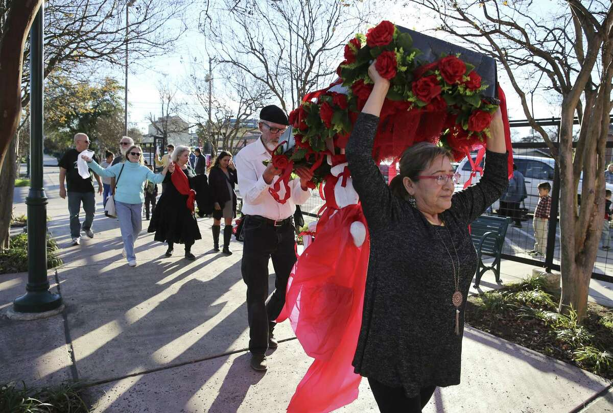 Araceli Herrera (front) and Jack Elder carry a mock coffin during a dance procession as the Sierra Club holds a press conference and a gathering with other organizations to celebrate the closing of the coal-fired J.T. Deely power plant on Saturday, Dec. 15, 2018. CPS Energy will shut down Deely at the end of 2018, marking the 4th coal-fired power plant to close this year.