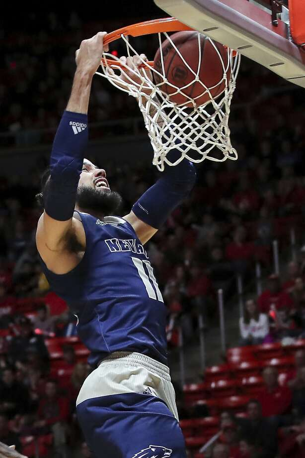 Forward Cody Martin dunks for Nevada, one of five unbeaten teams in the nation. Photo: Chris Nicoll / Associated Press