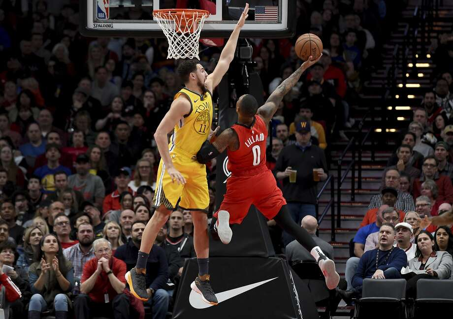Portland Trail Blazers guard Damian Lillard, right, puts up a shot on Golden State Warriors guard Klay Thompson, left during the first half of an NBA basketball game in Portland, Ore., Saturday, Dec. 29, 2018. (AP Photo/Steve Dykes) Photo: Steve Dykes / Associated Press