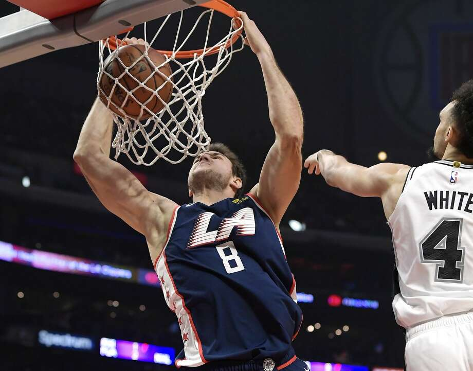Los Angeles Clippers forward Danilo Gallinari, left, dunks as San Antonio Spurs guard Derrick White defends during the second half of an NBA basketball game Saturday, Dec. 29, 2018, in Los Angeles. The Spurs won 122-111. (AP Photo/Mark J. Terrill) Photo: Mark J. Terrill/Associated Press