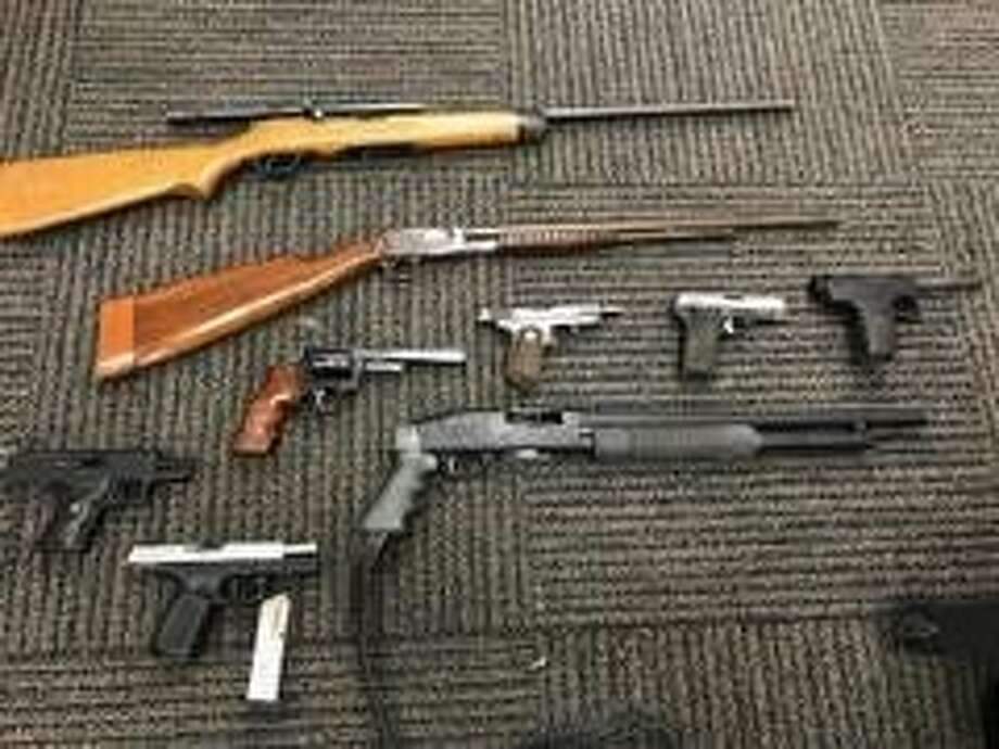Two Fairfield men were arrested after police located a cache of illegally owned weapons and methamphetamine. Photo: Fairfield Police Department