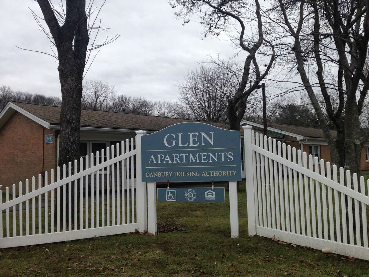 A man was killed and a woman injured by a Danbury officer at the Glen Apartments on Saturday night.