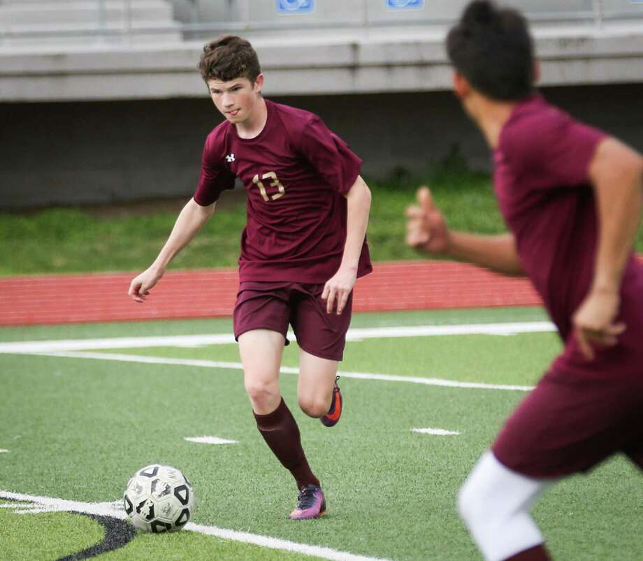 Magnolia West's Parker Hawks (13) moves the ball during the boys soccer game against Nacogdoches on Tuesday, April 3, 2018, at Yates Stadium in Willis. (Michael Minasi / Houston Chronicle) Photo: Michael Minasi, Staff Photographer / Houston Chronicle / © 2018 Houston Chronicle