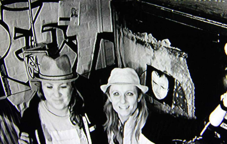 Escape Rooms Connecticut owners Michelle and Julie Mateus, right, pose through an infrared camera inside one of the escape rooms at their facility in Orange. Photo: Christian Abraham / Hearst Connecticut Media / Connecticut Post